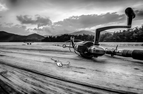 fishing tackle on a wooden float with mountain background in nc | by DigiDreamGrafix.com