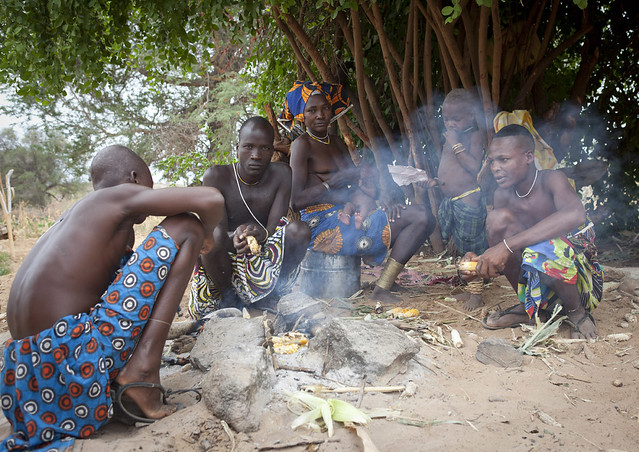 Mucubal Men Cooking And Eating Corn, Virie Area, Angola