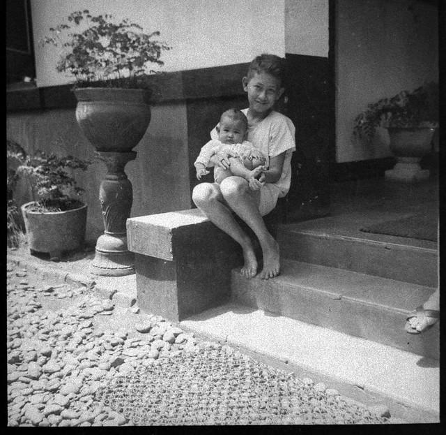 Otto van Waeterschoodt holding his youngest sister in Batavia in the Netherlands 1940