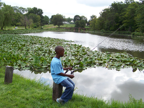 Photo of young angler fishing at a pond