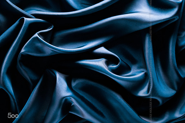 Abstract wave textile texture or background in blue color