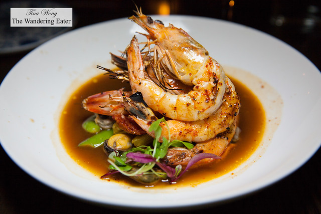 Grilled jumbo prawns with ramps, fava beans, fennel, saffron, mussels, cockles, lobster broth
