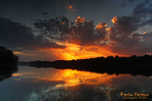 trees sunset sky sun reflection water yellow night clouds evening may 2013 kevinpovenz povenz