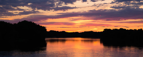 blue trees sunset red orange reflection water colors wisconsin clouds river calm mississippiriver backchannel