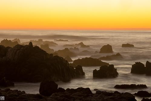 ocean california longexposure sunset orange beach rock coast rocks waves glow pacificocean layers pacificgrove asilomar californiacoast