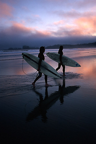 Surfers return to Long Beach on the West Coast of Vancouver Island, British Columbia, Canada