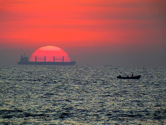 A ship loaded with the setting sun, Kovalam, India