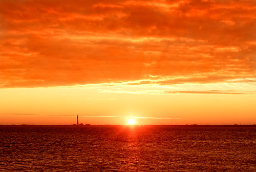 ocean light sea sky orange sun sunlight lighthouse ny water sunshine clouds sunrise island dawn seaside long waves waterfront rays seashore atlanticocean sunbeam goldenhour hdri warmcolors suffolkcounty fireislandnationalseashore