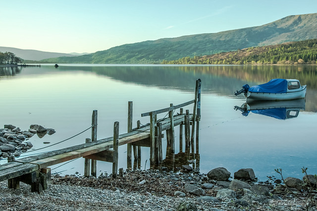 Loch Arkaig. Serenity, still-water, jetty, boat, stony beach and a little piece of heaven.