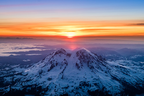 sky mountain mountains clouds sunrise us washington nationalpark unitedstates nps edgewood mountrainier mountrainiernationalpark aerialphoto nationalparkservice goldenhour windowseat stratovolcano giffordpinchotnationalforest nps100