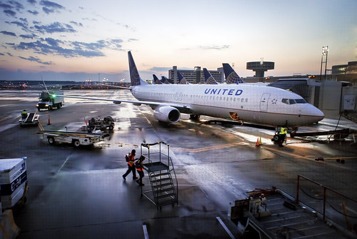 sunset rain airplane airport united houston