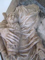 dead baby wrapped in swaddling