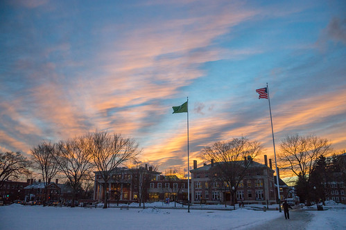 winter sunset flags dartmouth robinsonhall thegreen collisstudentcenter