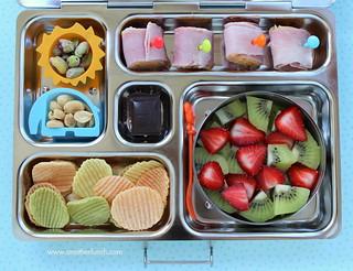 Kindergarten school lunch - ham & cheese rolls, nuts, veggie chips, strawberries and kiwi, organic dark chocolate   by anotherlunch.com