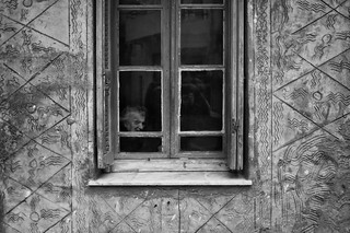 Old woman staring through a window | by Spyros Papaspyropoulos