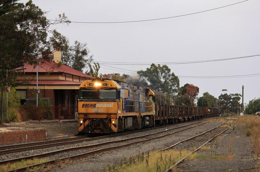 NR45 and NR44 head a short loaded steel train through Horsham station by bukk05
