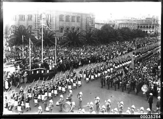Royal Navy ratings marching with the Royal Marines Band Service marching in Sydney