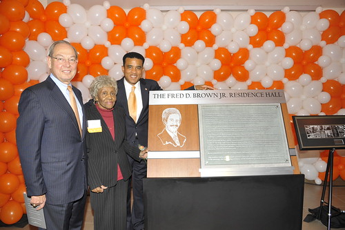 Chancellor Jimmy G. Cheek, Thelma Brown, and former BOT member Spruell Driver with the Fred D. Brown Jr. plaque.