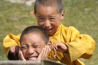 Child monks joking by ear pinching, and he does it with compassion, Tibet 2013 | by reurinkjan
