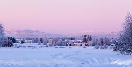 Pink sky over little settlement   by Studio_de_Raaf