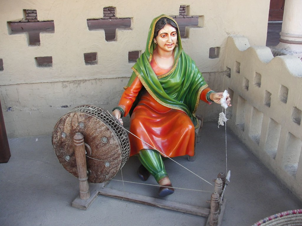 Punjaban With her Charkha | Charkha refers to a small spindl