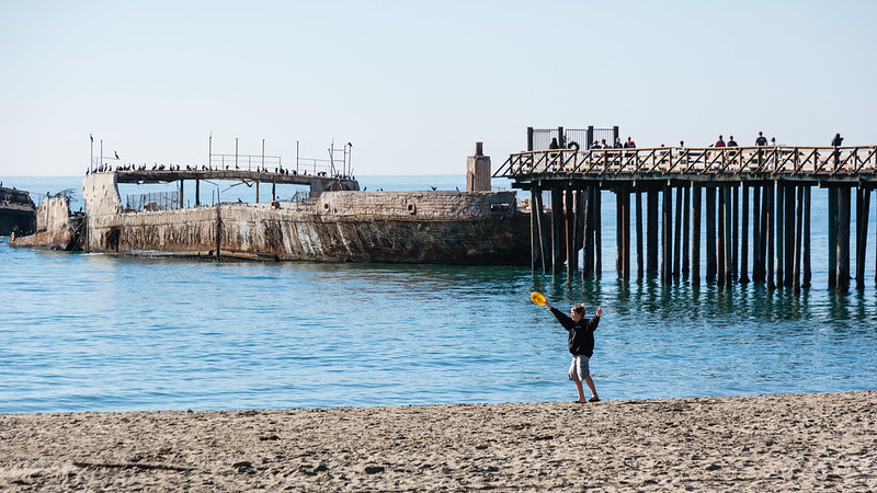 Kid Playing Frisbee at Seacliff State Beach