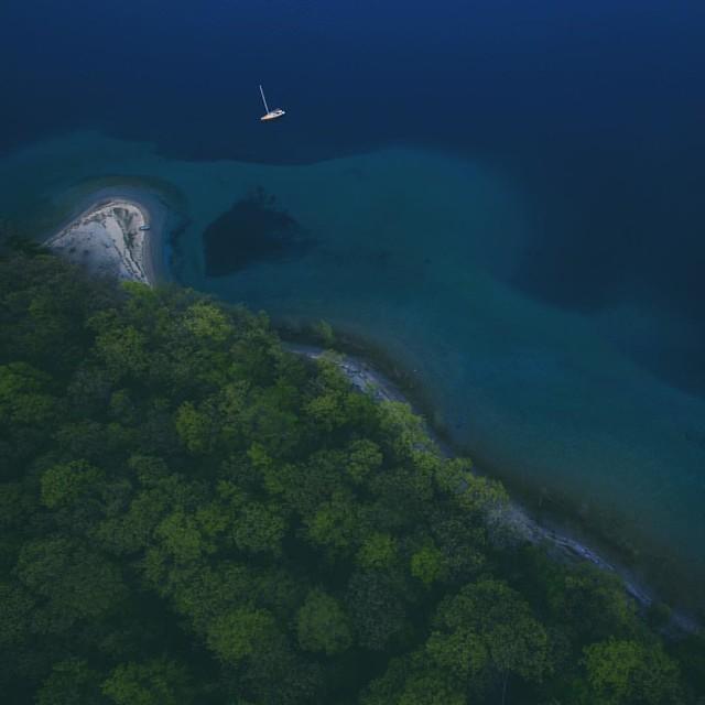 Moored in Grand Traverse Bay, Lake Michigan. #puremichigan #bluehour #island #sailing #greatlakes #drone #dji #dronestagram #fromaboveseebelow