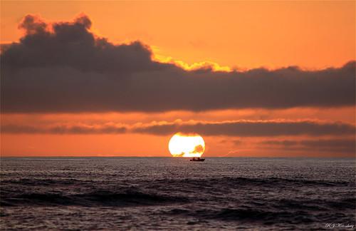 sunset sea newzealand cloud beach canon boat cook wave northisland aotearoa strait kapiti paraparaumu 500d