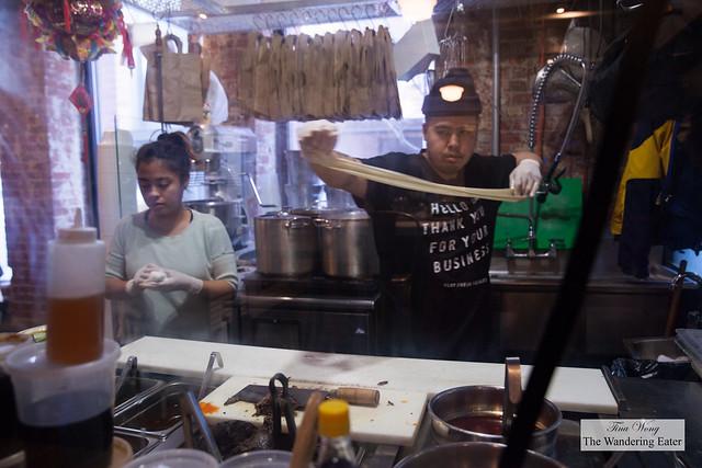 Co-owner Victor pulling the noodles