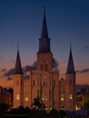 city travel blue sunset urban orange church architecture evening la louisiana catholic glow cathedral dusk neworleans religion stainedglass jacksonsquare bluehour nola stlouiscathedral minorbasilica cathedralbasilicaofsaintlouis menefee michaelmenefee cathedralbasilicaofsaintlou