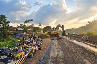 Road work and roadside market in Cameroon   by jbdodane