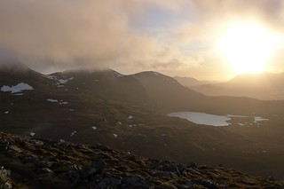 Sunlight and cloud over the Fannaichs | by Nick Bramhall