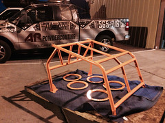 Roll cage primer and top coated orange.
