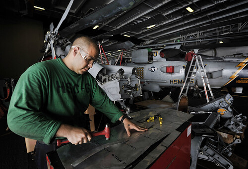 Sailor fabricates part for MH-60S aboard USS Nimitz. | by Official U.S. Navy Imagery