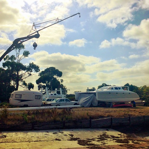 Catamaran, cars, caravan and crane. | by miaow
