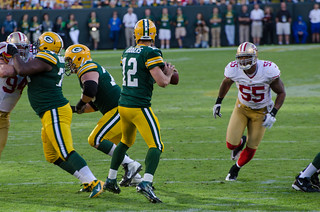Aaron Rodgers, Ahmad Brooks | by Mike Morbeck