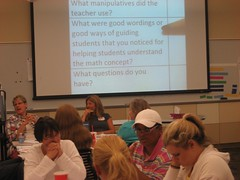 After experiencing the lesson that a team developed, teachers discuss how the activities in the lesson will support student learning. (Summer 2011)