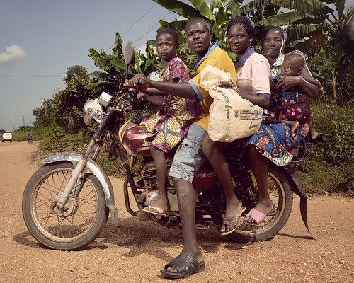 The driver of this taxi-moto pauses on a country road in Athiémé | by World Bank Photo Collection
