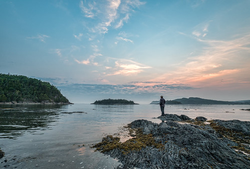 ocean park travel trees sunset sea sky people plants canada man tourism nature water st clouds sunrise river out landscape outside person lawrence rocks view quebec outdoor scenic dramatic rocky adventure shore stlawrence lone destination stareing bicpark