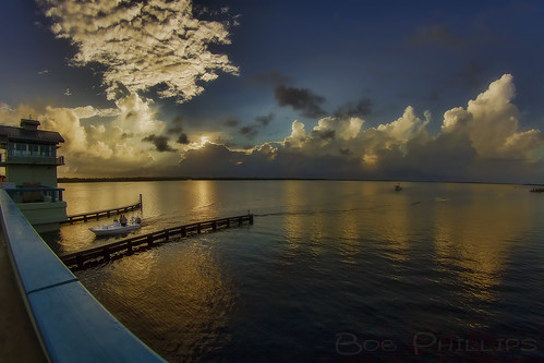 gulfofmexico clouds sunrise boat fishermen florida palmtrees drawbridge matlacha pineislandsound
