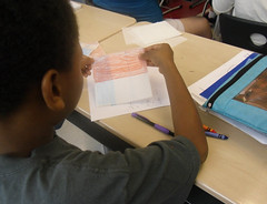 A 5th grade student was trying to find a way to find the common denominator by overlaying two sheets of patter paper. Teachers realized that asking what he was trying to do may help him develop his own idea. (April 2012, Gr 5)