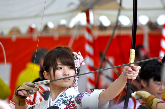 Japanese Girl Doing Kyudo at an Archery Event in Kyoto