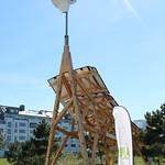 Giraffe at Västra Hamnen with Tesla Roadster charging