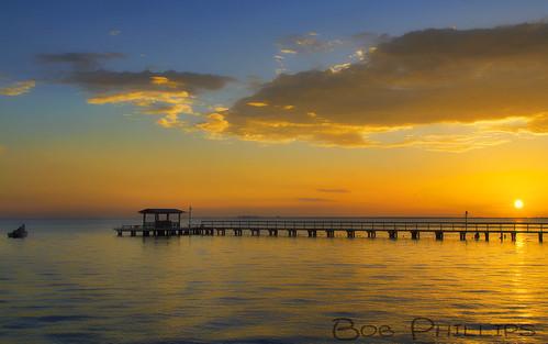 gulfofmexico clouds sunrise pier florida fishingboat pineisland bokeelia