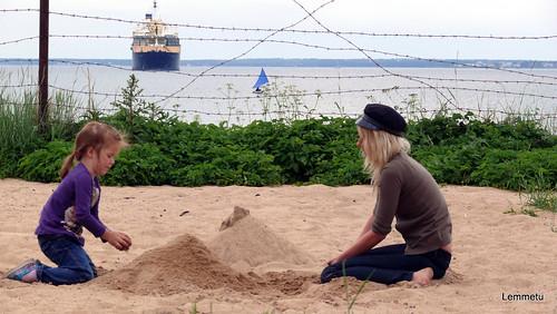 Patarei-castle-prison sand beach, building a sand castle, under NATO's protective gaze.