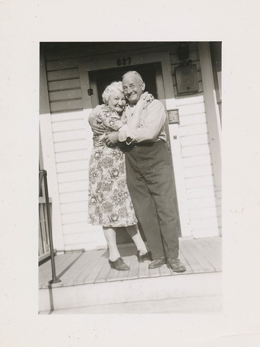 Affectionate elderly couple hugs on the porch | by simpleinsomnia