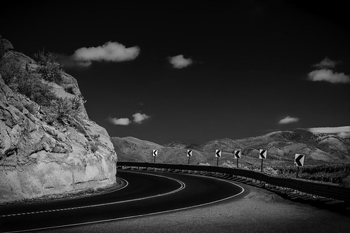 road sky blackandwhite bw usa signs mountains newmexico clouds landscape ir photography countryside us photo highway rocks photographer unitedstates image fav50 unitedstatesofamerica july fav20 100mm photograph infrared 100 nm f56 curve fav30 turning losalamos fineartphotography roadscape architecturalphotography commercialphotography fav10 fav100 720nm 2013 fav40 fav60 architecturephotography fav90 fav80 fav70 losalamoscounty houstonphotographer ¹⁄₁₂₅sec ef100mmf28lmacroisusm mabrycampbell july32013 20130703img0162