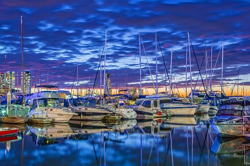 sunset sky clouds boats goldcoast sunsetsandsunrisesgold cloudsstormssunsetssunrises slowshutteronwater