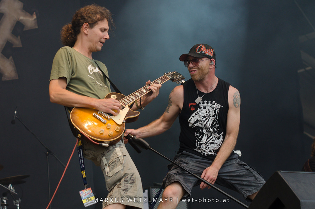 """Austrian Hard Rock band ALKBOTTLE performing live at See Rock 2013 Festival near Schwarzl See, Graz, Styria, Austria on June 21, 2013 as replacement of UK Hard Rock band MOTÖRHEAD who had to cancel their gig due to health problems.  © Markus Wetzlmayr   <a href=""""https://www.wet-photo.at"""" rel=""""noreferrer nofollow"""">www.wet-photo.at</a> NO USE WITHOUT PERMISSION."""