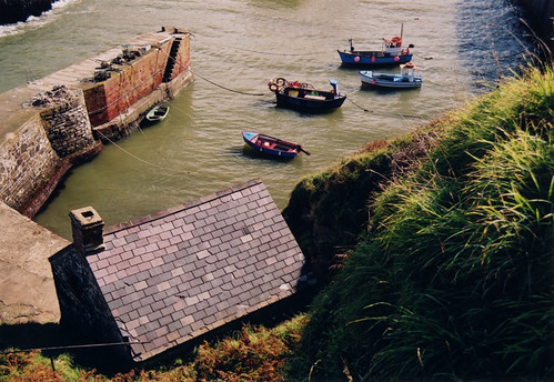 Boats in a harbour, one of the sights along the Pembrokeshire Coastal Path in Wales